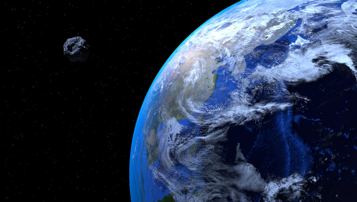 An artist's concept of an asteroid passing quite close to Earth.