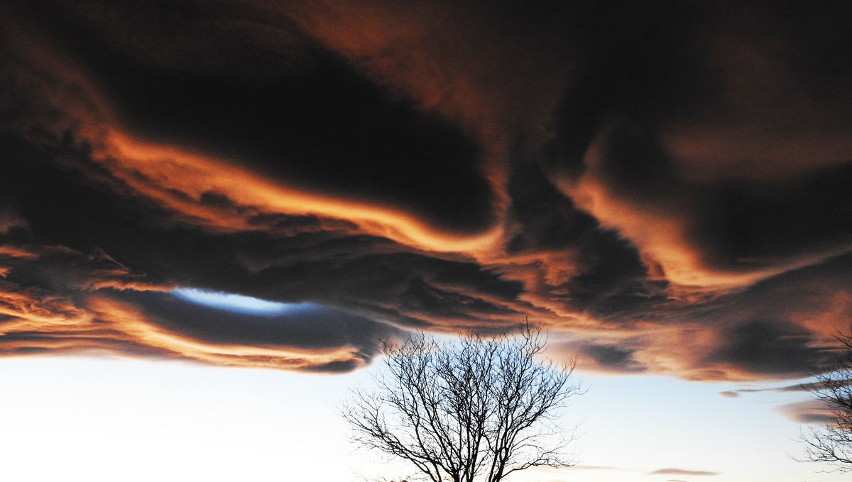 Incredible cloud display on Nov. 19, 2017 over Colorado, caused by rising air over the mountains. Credit: Phil Plait