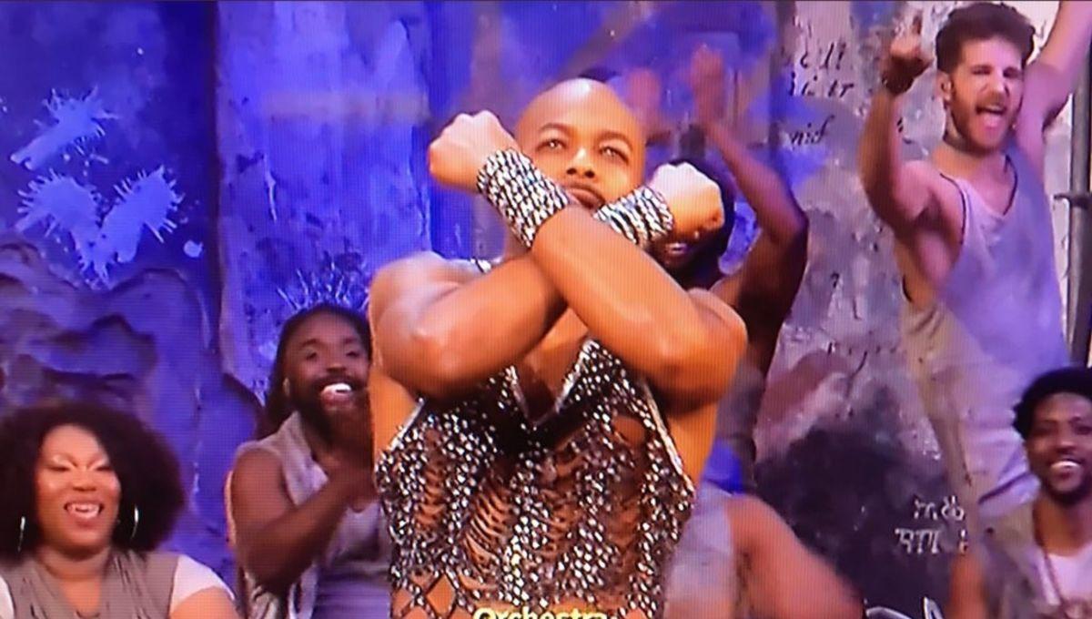 Brandon Victor Dixon givign the Wakanda salute
