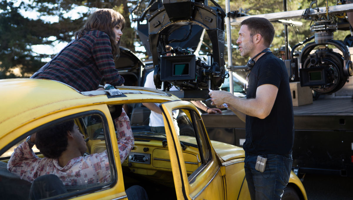 Jorge Lendeborg Jr., Hailee Steinfeld and Director Travis Knight on the set of Bumblebee