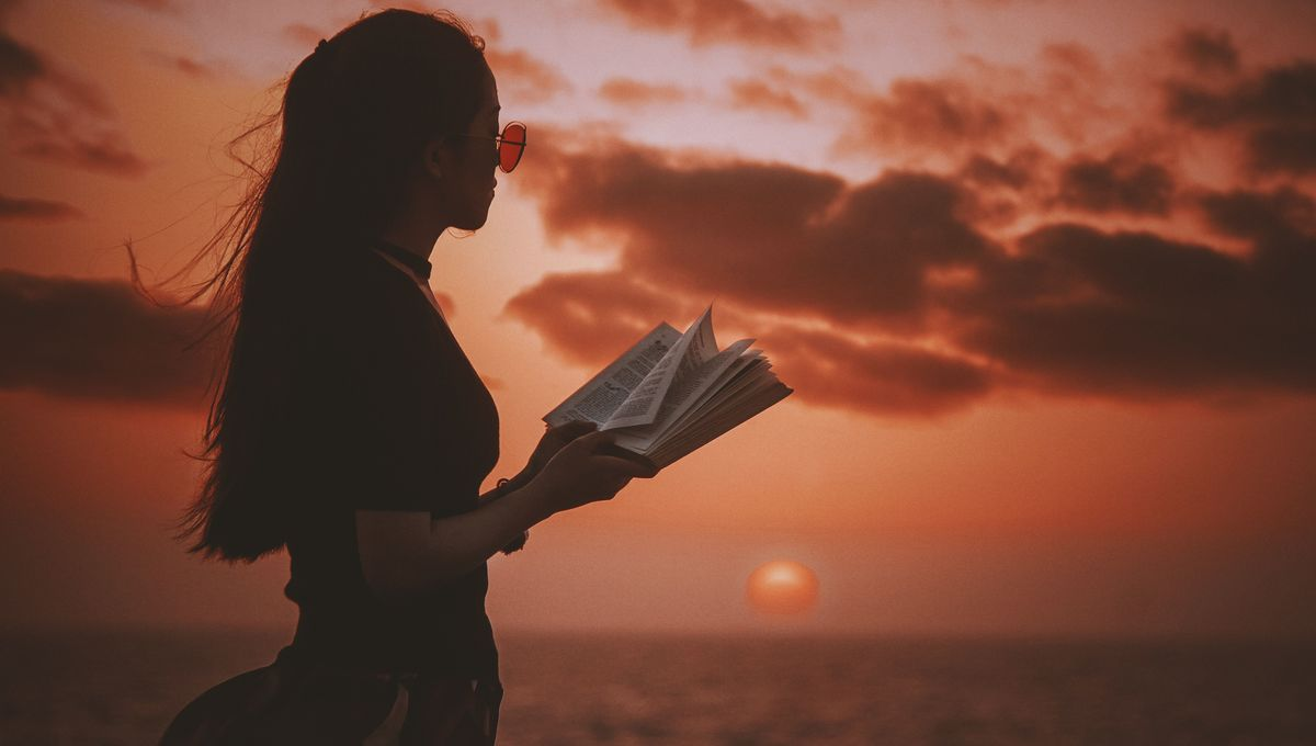 woman-reading-at-sunset