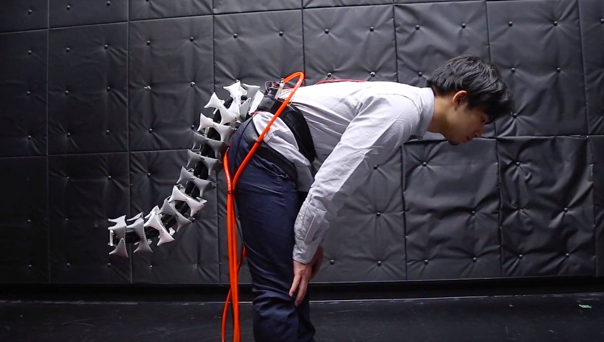 A demonstrator wearing an artificial robotic tail for humans