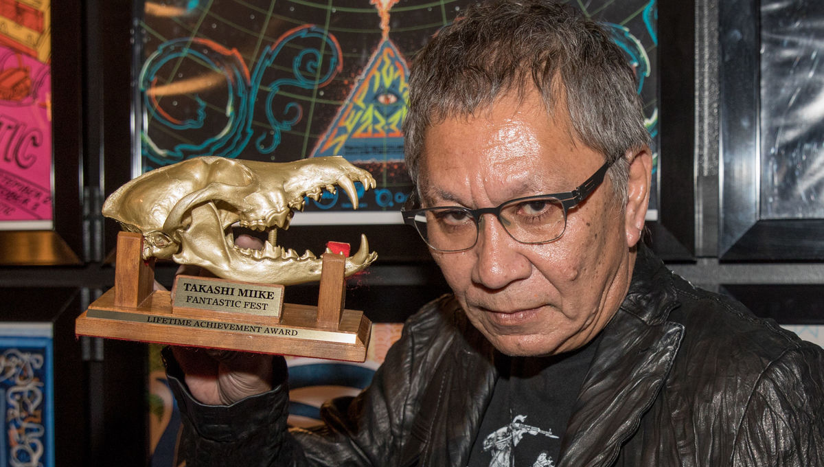 Director Takashi Miike poses with his Fantastic Fest Lifetime Achievement Award