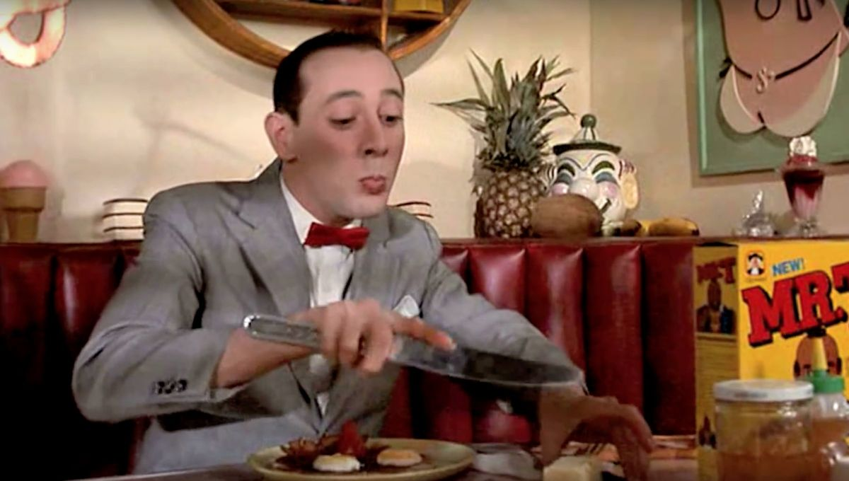 Pee-wee Herman eats breakfast (Pee-wee's Big Adventure)