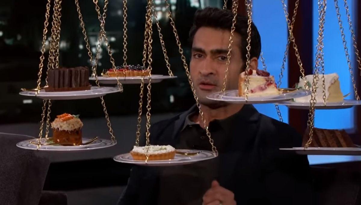 Kumail Nanjiani surrounded by cakes