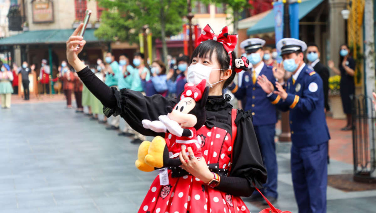 A guest at Shanghai Disneyland's reopening