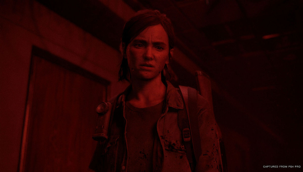 Ellie framed by red light in The Last of Us Part II