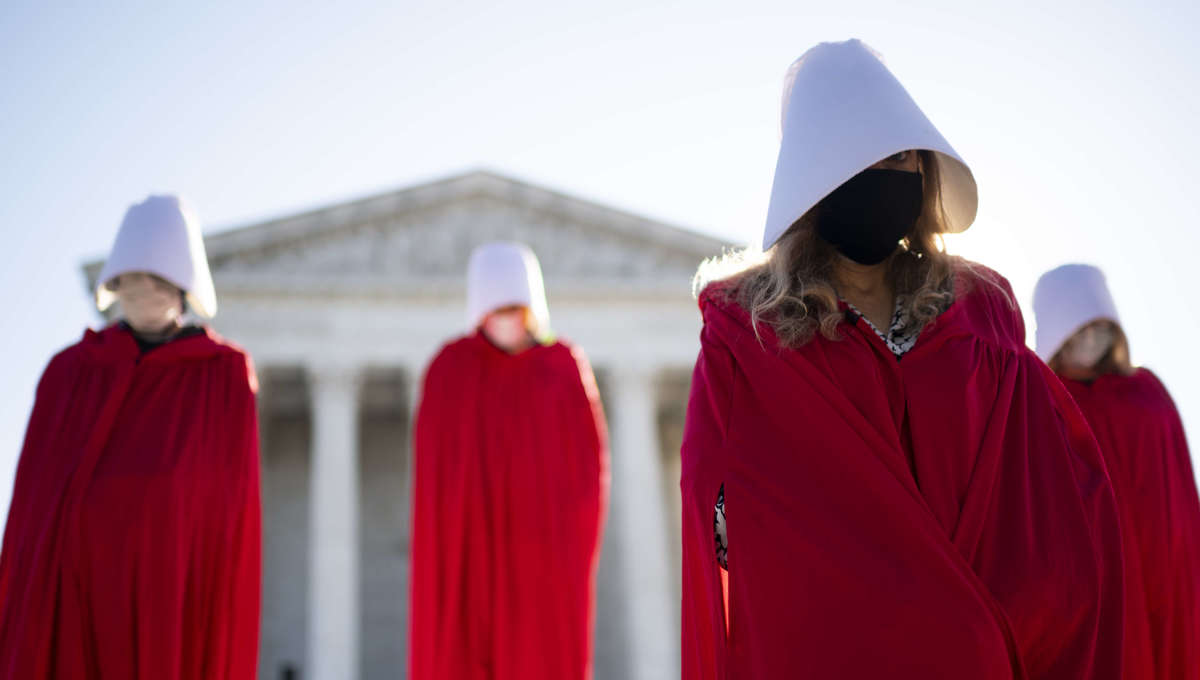 Women in Handmaids Tale robes protest Amy Coney Barrett at Supreme Court