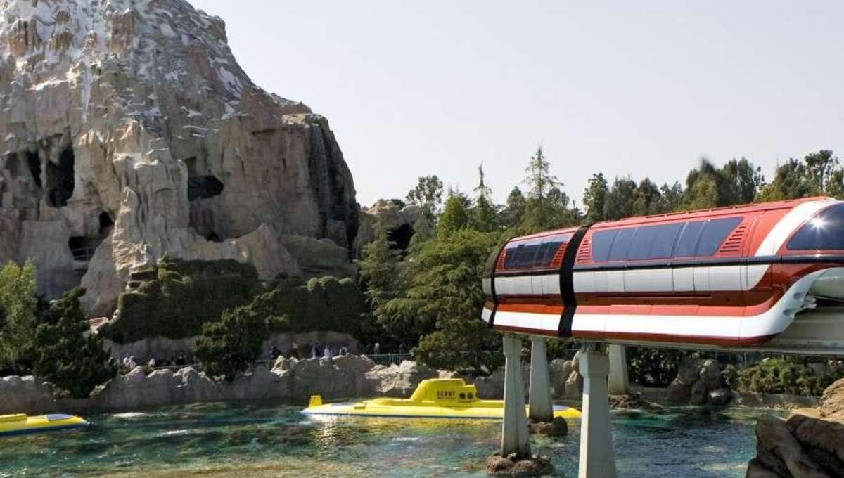 Disneyland Monorail passing by its Matterhorn Mountain