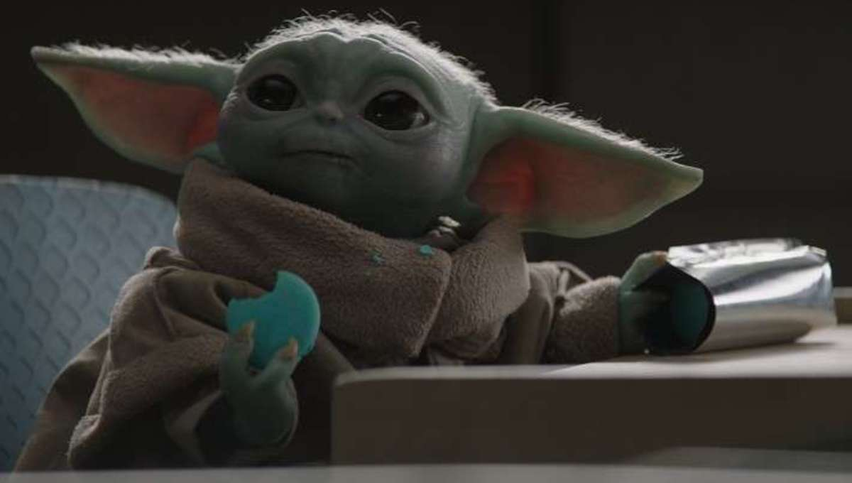 Baby Yoda eating blue cookie