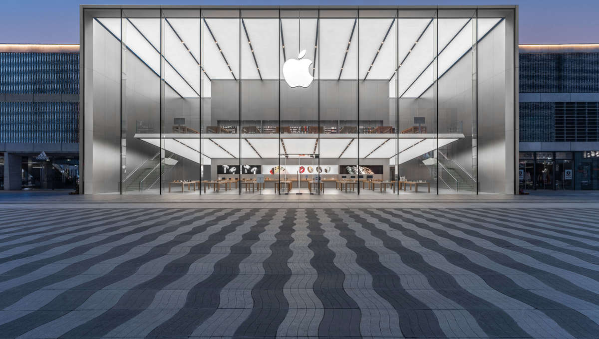 The Apple logo displayed on the facade of an Apple Store