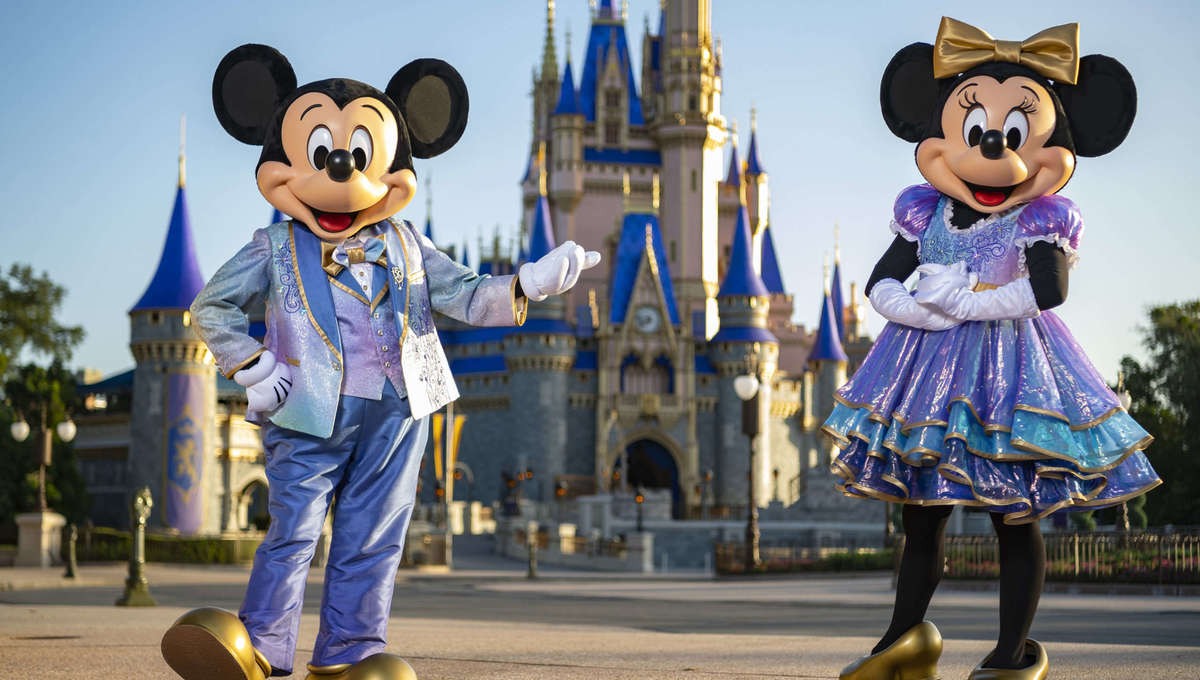 Mickey and Minnie Mouse in their 50th Anniversary costumes