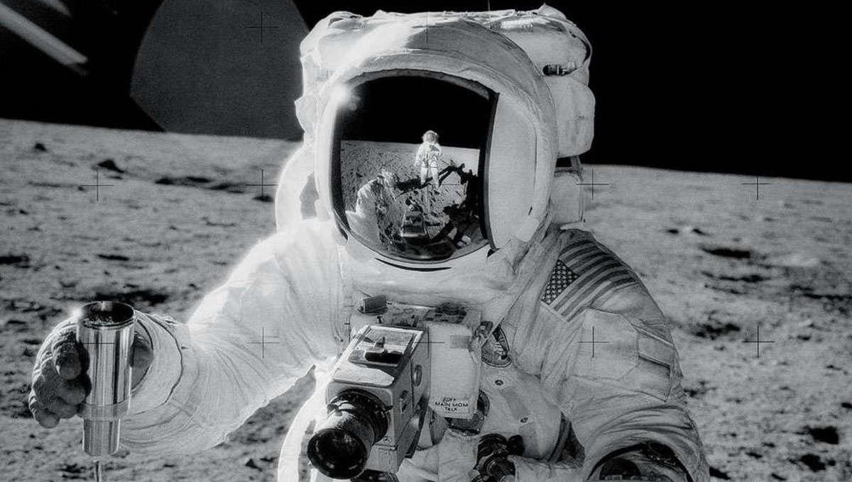Apollo astronaut with sample