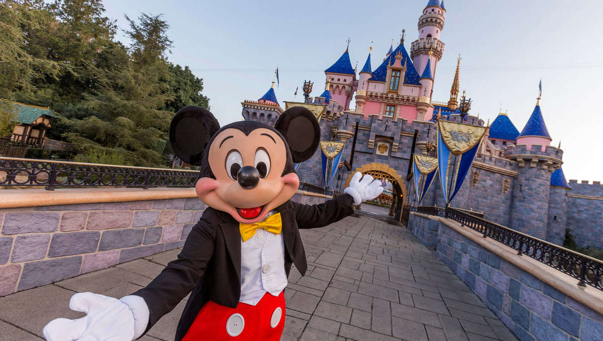 Mickey Mouse in front of Sleeping Beauty Castle