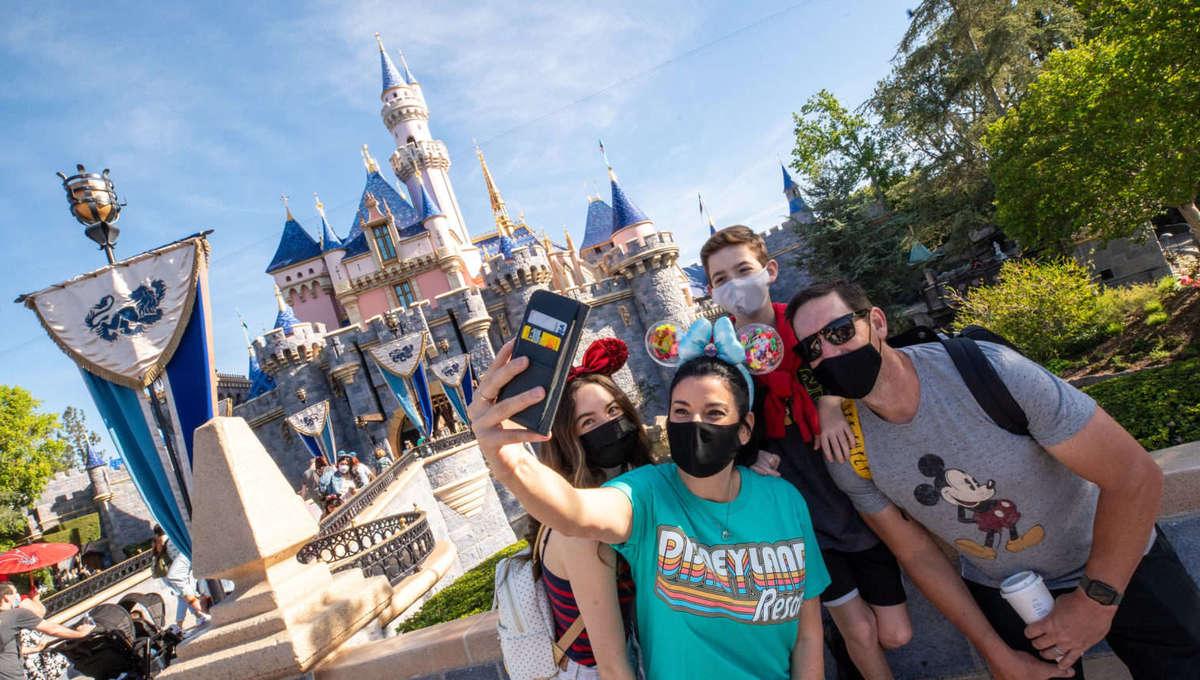 Guests in front of Disneyland's Sleeping Beauty Castle