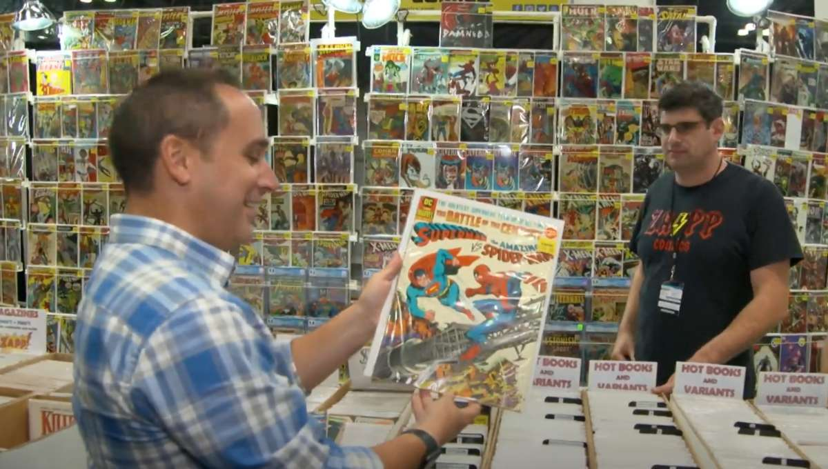 Mike Avila searching for printed treasure at a comic con