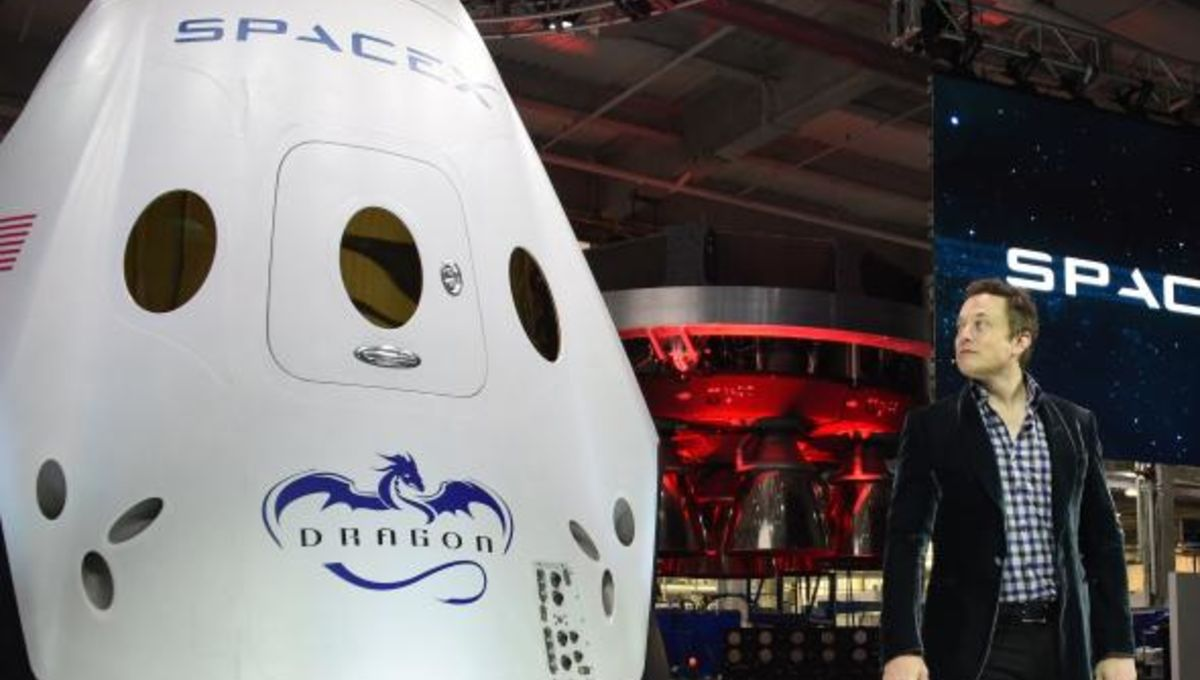 Elon Musk next to the recently unveiled SpaceX Dragon V2 capsule, designed for human flight. Credit:  Robyn Beck/AFP/Getty Images