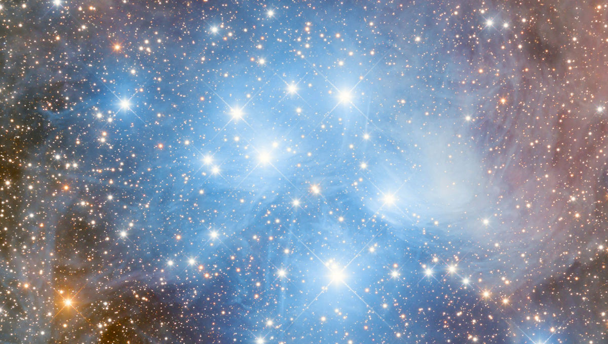Detail of the central part of the Pleiades, showing more resolution on the wisps of dust reflecting the light of the brightest cluster members. Credit: Adam Block /Steward Observatory/University of Arizona