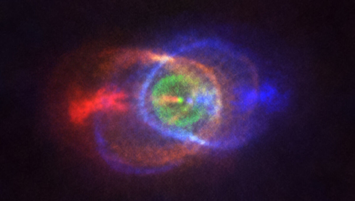 Gas ejected from the binary star system HD 101584 forms an overall hourglass-shaped nebula. Colors represent velocities: Red is away from us, blue toward us, and green neither toward nor away. Credit: ALMA (ESO/NAOJ/NRAO), Olofsson et al.
