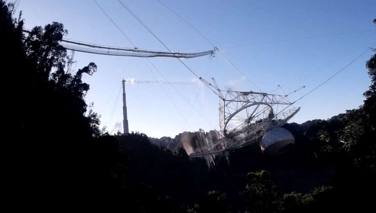 A still from the video of the Arecibo radio telescope collapse shows the massive 900-ton platform swinging down after supporting cables snapped. Credit:Courtesy of the Arecibo Observatory, a U.S. National Science Foundation facility