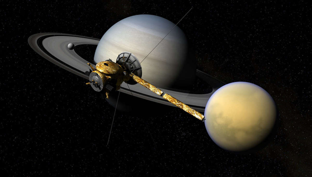 Phenomenal artwork depicting the Cassini spacecraft near Saturn and its huge moon Titan. Credits: Cassini Model: Brian Kumanchik, Christian Lopez, NASA/JPL-Caltech, and updated by Kevin M. Gill