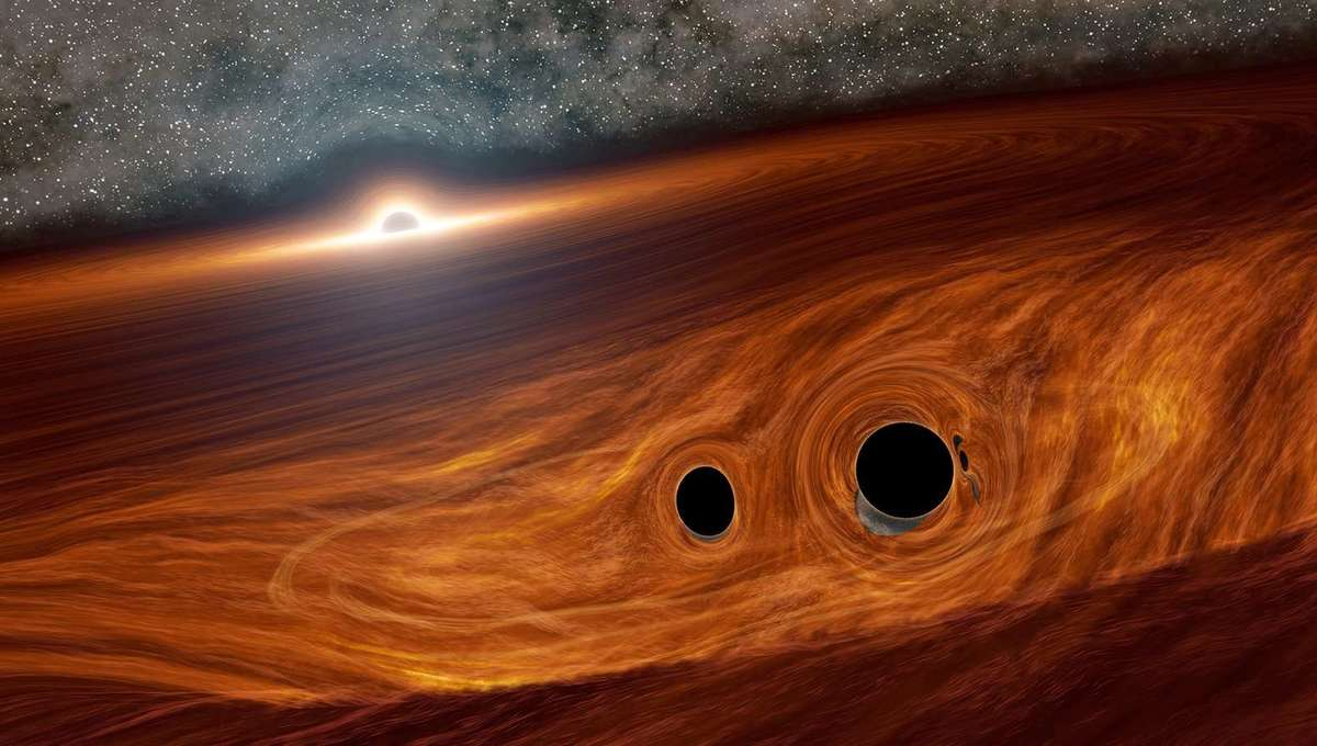 A binary pair of black holes about to merge together, near the huge disk of material swirling around a supermassive black hole in a distant active galaxy. Credit: Caltech/R. Hurt (IPAC)