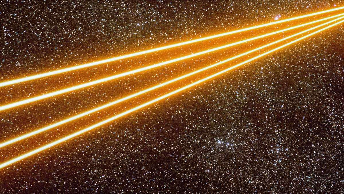 Four powerful lasers fire from the Very Large Telescope to create artificial guide stars in the sky near the Carina Nebula. Credit: ESO/G. Hüdepohl