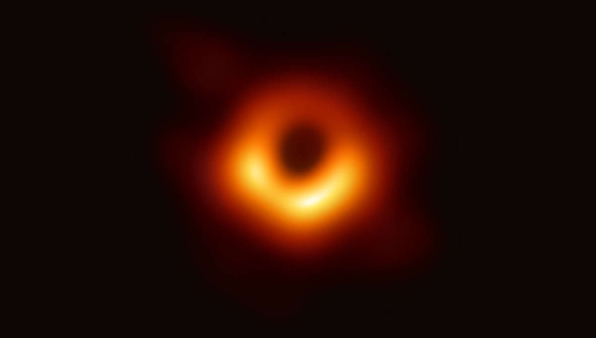 """The very first image of the """"shadow"""" of a supermassive black hole. This shows the region around a black hole with a mass 6.5 billion times that of the Sun, located 55 million light years away from Earth in the core of the galaxy M87. Credit: NSF"""