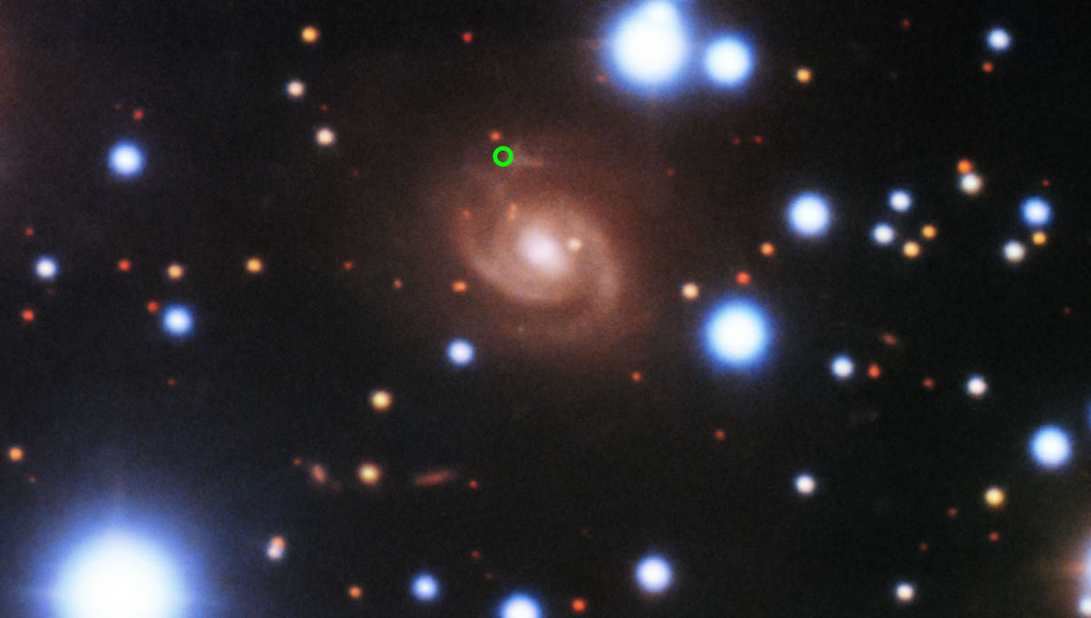 The 8.2-meter Gemini North telescope took this image of the location of the fast radio burst FRB 180916.J0158+65 (green circle), which is in a star-forming region of a spiral galaxy about 500 million light years from Earth. Credit: Gemini Observatory