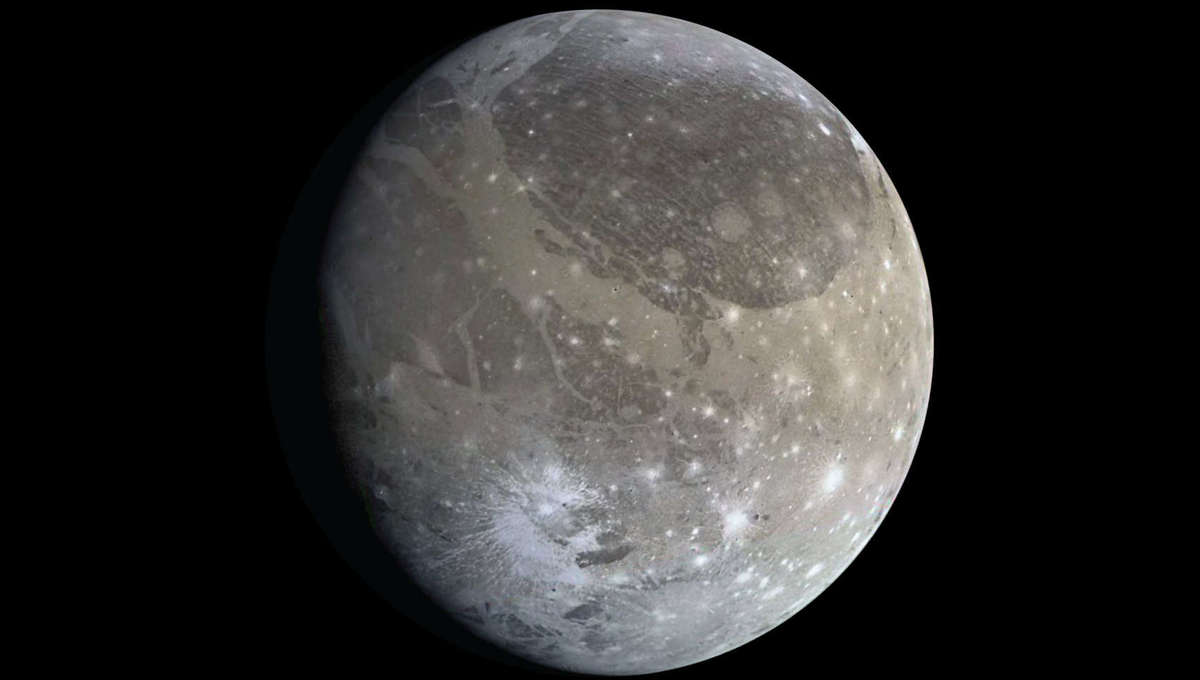 Jupiter's moon Ganymede, showing the dark and light terrains; the furrows can be seen to the upper right in the dark terrain. Credit: NASA / JPL-Caltech / Emily Lakdawalla