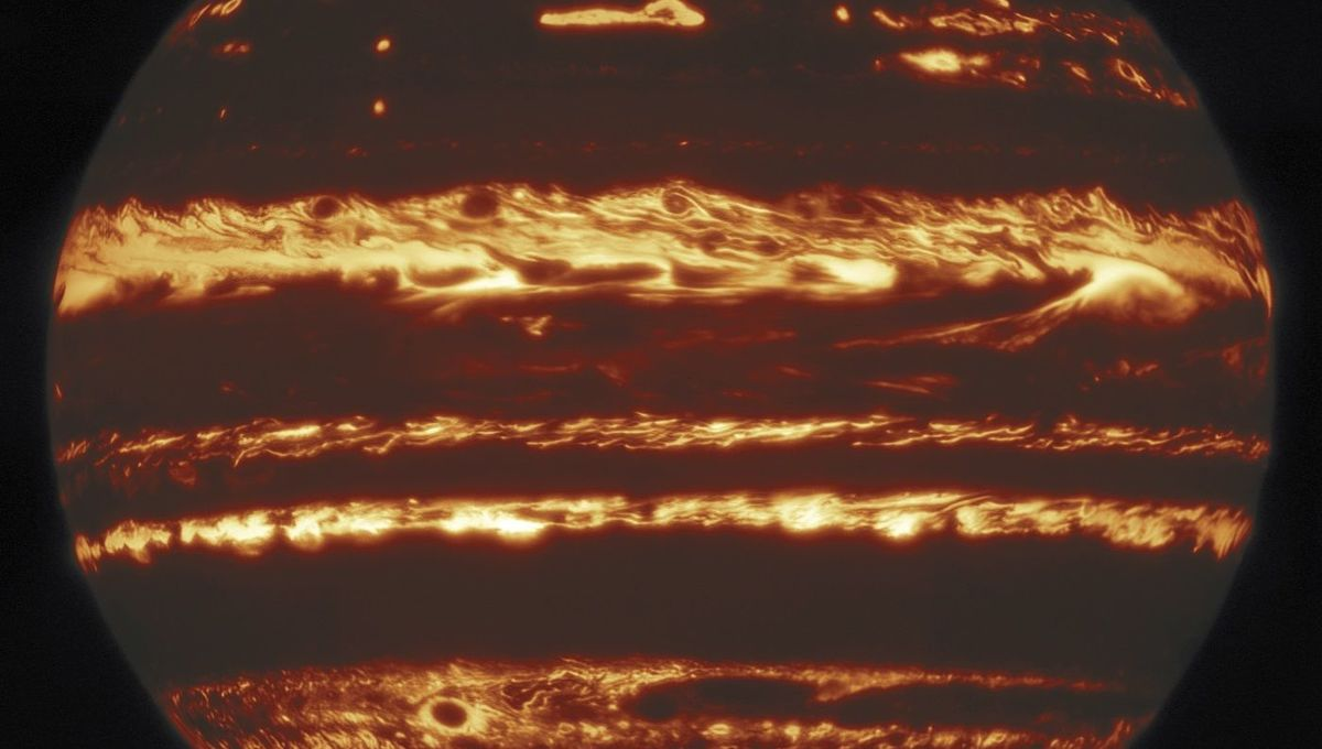 Jupiter in thermal infrared light; bright regions are clear air where heat from inside the planet can leak out, while darker regions are where clouds block that heat.