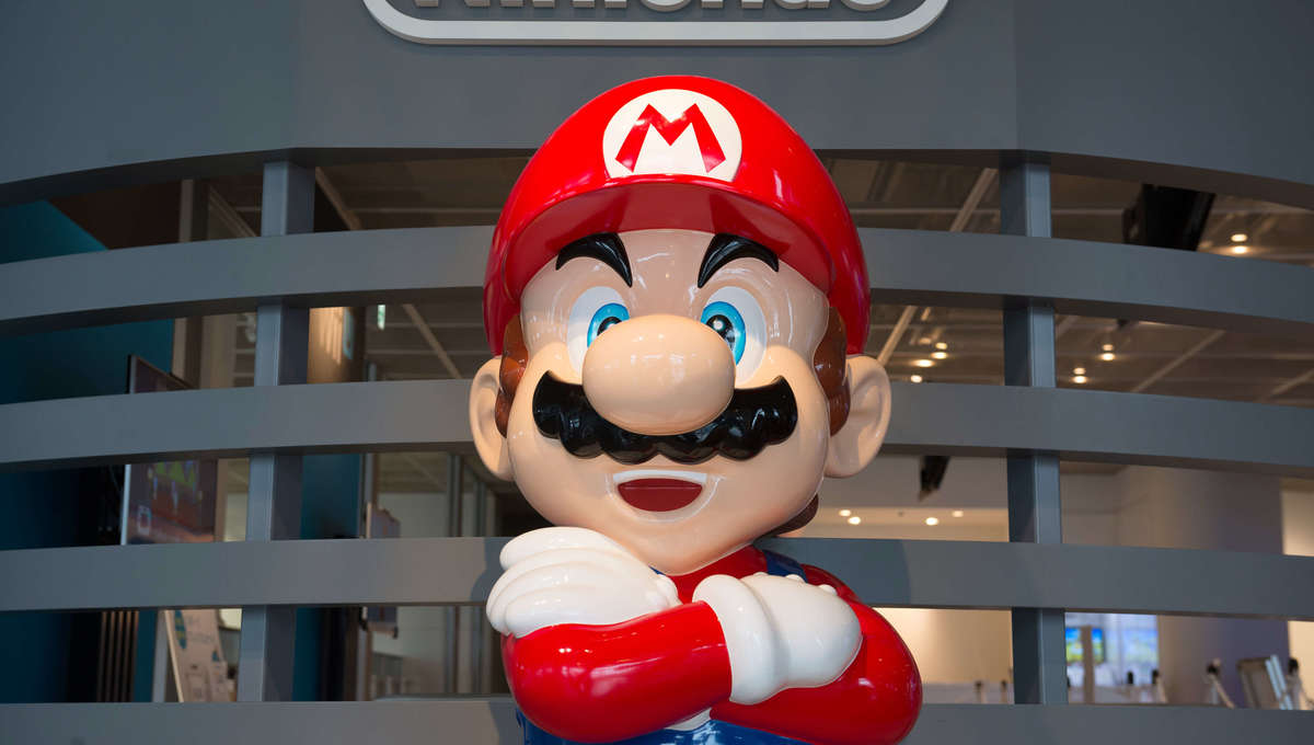 Mario stands at the Nintendo Game Front showroom i