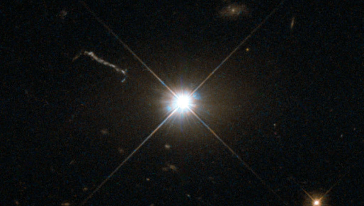 A deep Hubble image of the quasar 3C 273 shows it as a blazing point source, almost like any other star. The linear feature to the upper left is a jet of material accelerated by the quasar's black hole central engine. Credit: ESA/Hubble & NASA