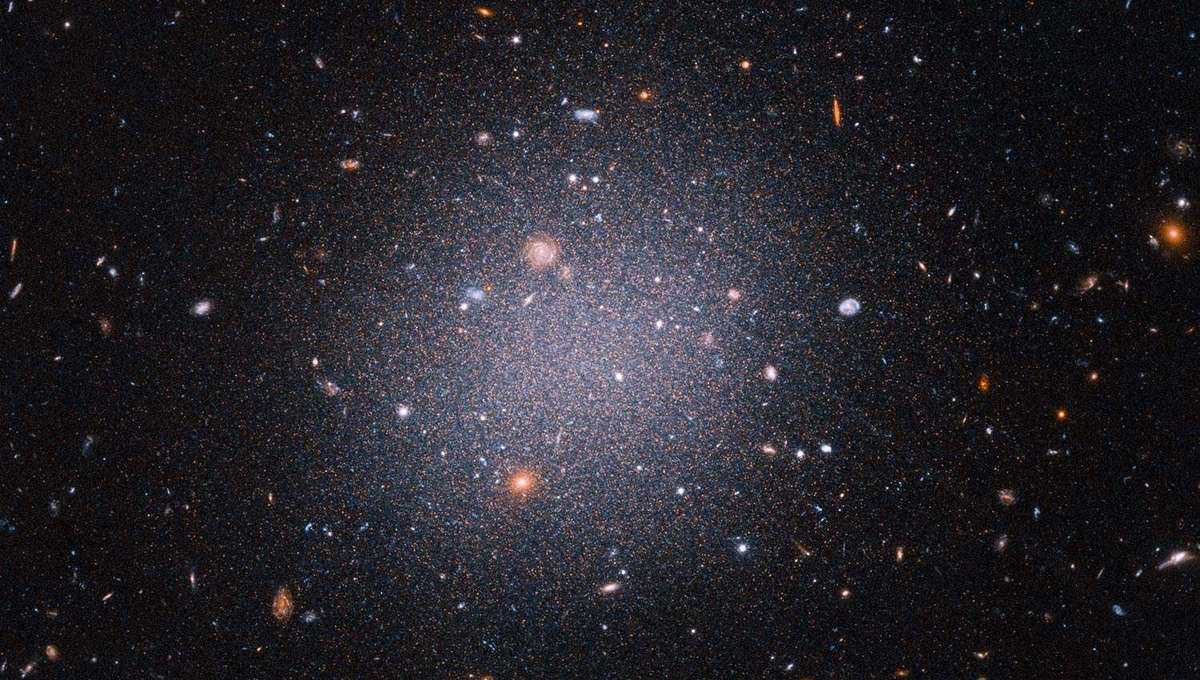 The ultra-diffuse dwarf galaxy NGC 1052-DF2, seen here using Hubble, apparently has little or no dark matter. It's not clear how this happened. Credit: NASA, ESA, STScI, Zili Shen (Yale), Pieter van Dokkum (Yale), Shany Danieli (IAS) Image processing: Aly