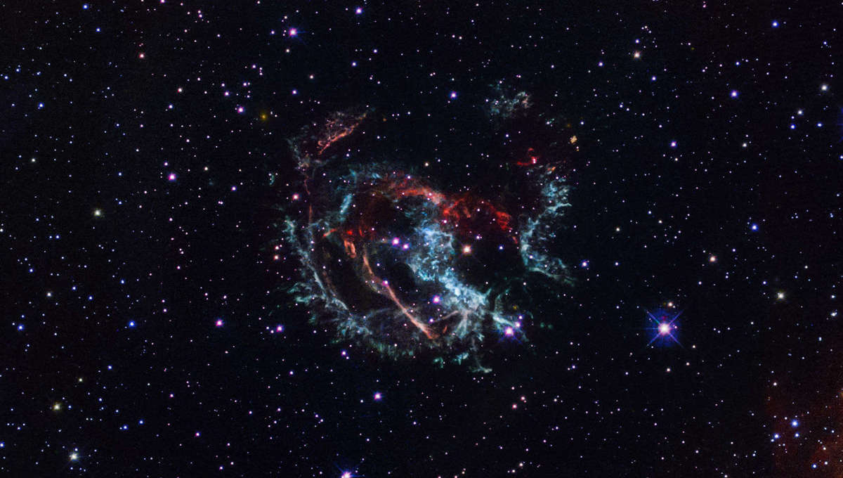 The supernova remnant 1E 0102.2-7219, seen by Hubble Space Telescope. Careful measurements of the expanding debris over time has indicated the star blew up 1738 (±175) years ago. Gas colored blue is moving toward Earth, gas colored red moving away.