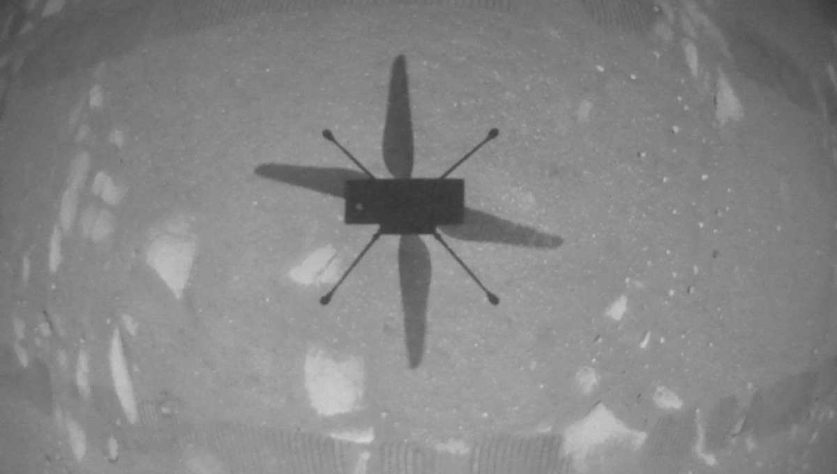 The Mars helicopter Ingenuity sees its own shadow on the surface of Mars using a downward-facing camera as it hovered. Credit: NASA/JPL-Caltech