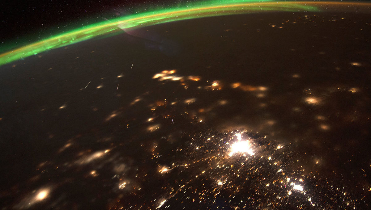 A composite photo (made up of several individual pictures) of Quadrantid meteors burning up over Earth, taken from the International Space Station on 4 January, 2020. The green glow of the aurora borealis is seen to the north. Credit: NASA