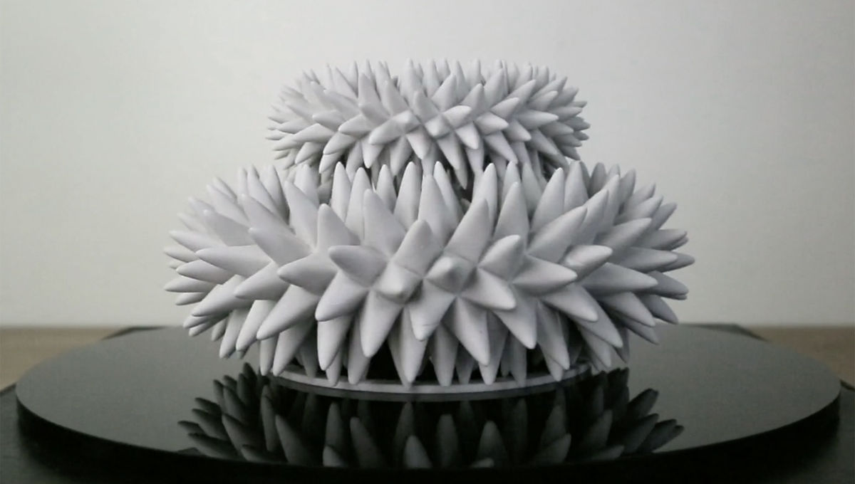A 3D printed sculpture appears to wiggle and move when spun and lit by a strobe light on video. Credit: John Edmark, from the video
