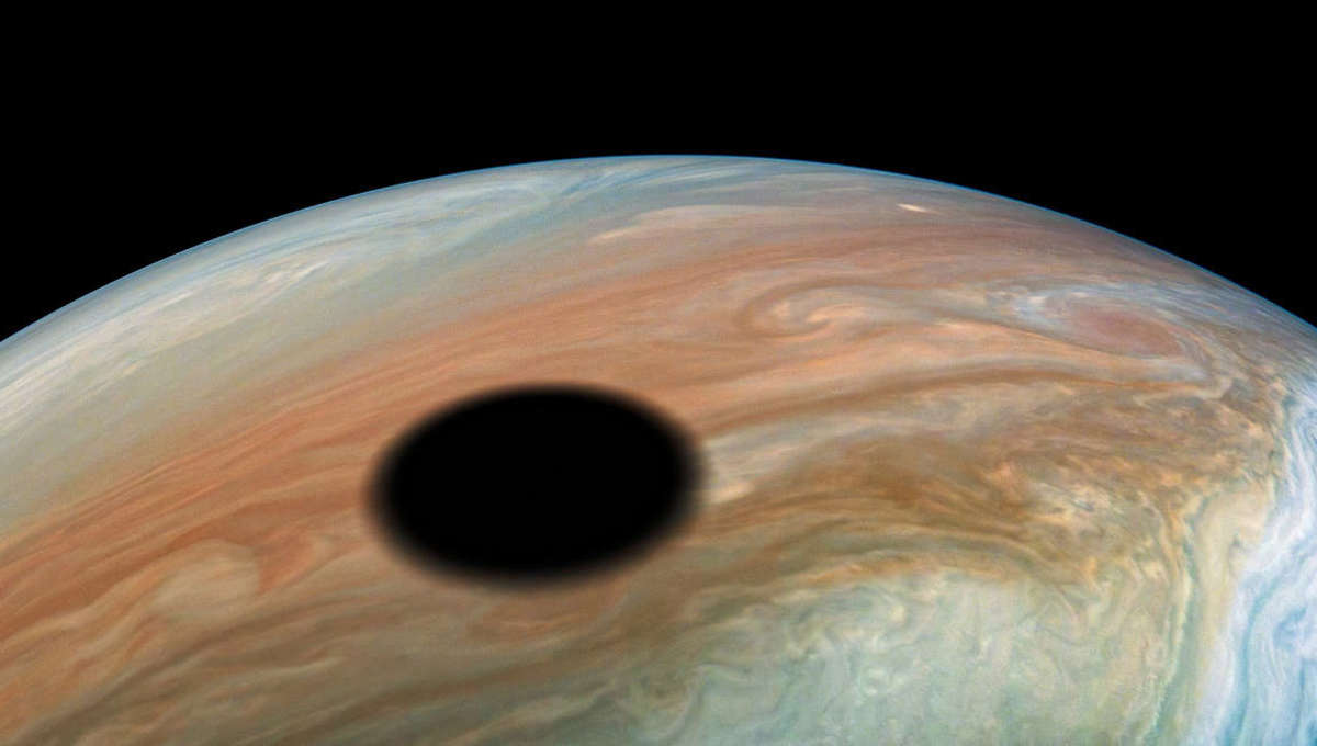 The shadow of Jupiter's moon Io on its cloud tops. Credit: NASA/JPL-Caltech/SwRI/MSSS/Kevin M. Gill