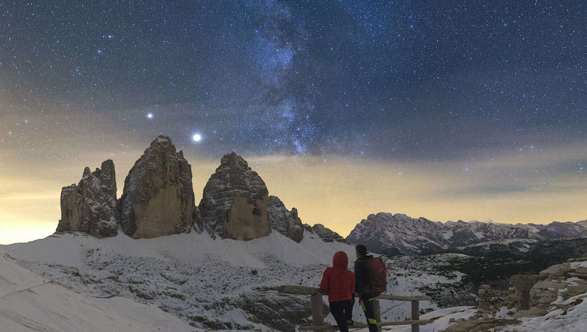 A couple, including the photographer, watch Jupiter and Saturn and the Milky Way over the Tre Cime di Lavaredo in the Italian Alps in early October 2020. Credit: Giorgia Hofer