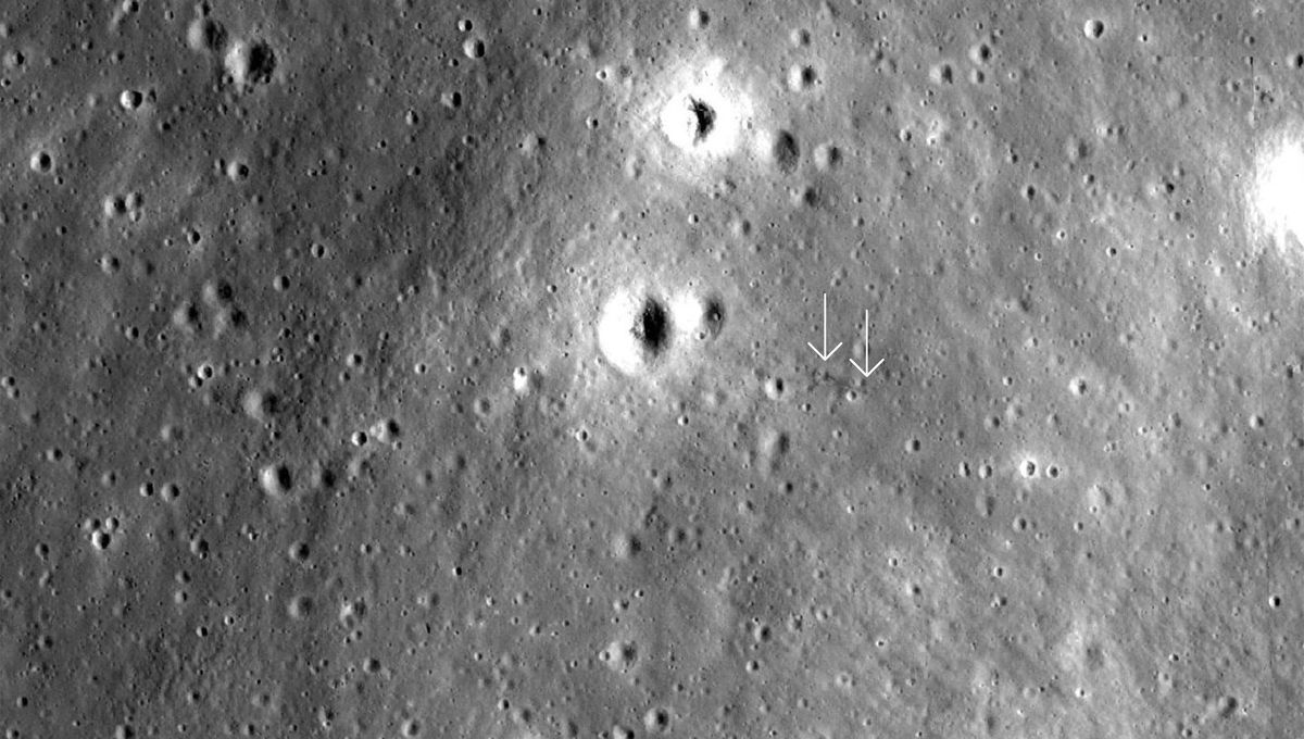 An area of the Moon where the Apollo 12 Ascent stage may have crashed, leaving a dark furrow in the surface (arrowed). Credit: NASA/GSFC/Arizona State University / Quickmap