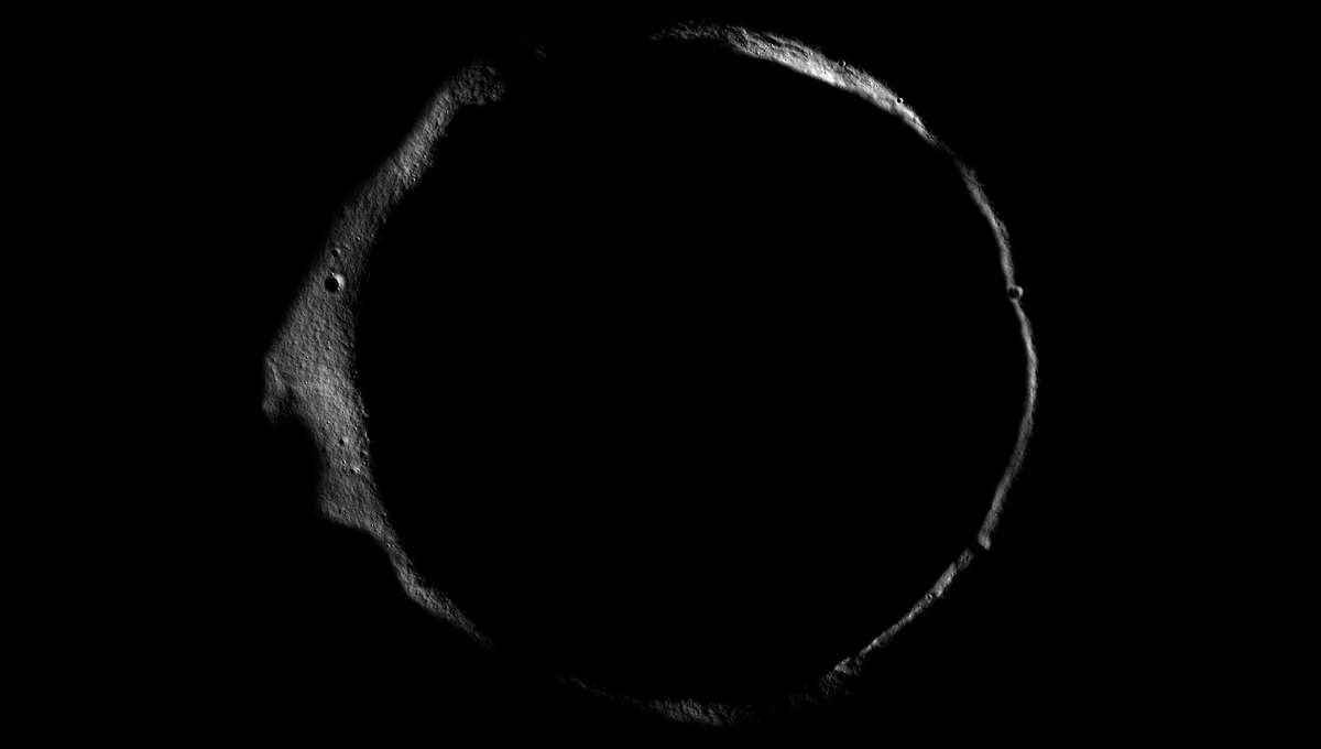 Erlanger crater, near the Moon's north pole, with just its rim lit by low sunlight. Much of the crater's floor is in permanent darkness. Credit: NASA/GSFC/Arizona State University