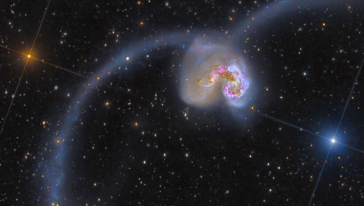 The Antennae Galaxies, a pair of colliding spiral galaxies 45 million light years away. Credit: NASA/ESA/ESO/NAOJ, Rolf Olsen and Federico Pelliccia