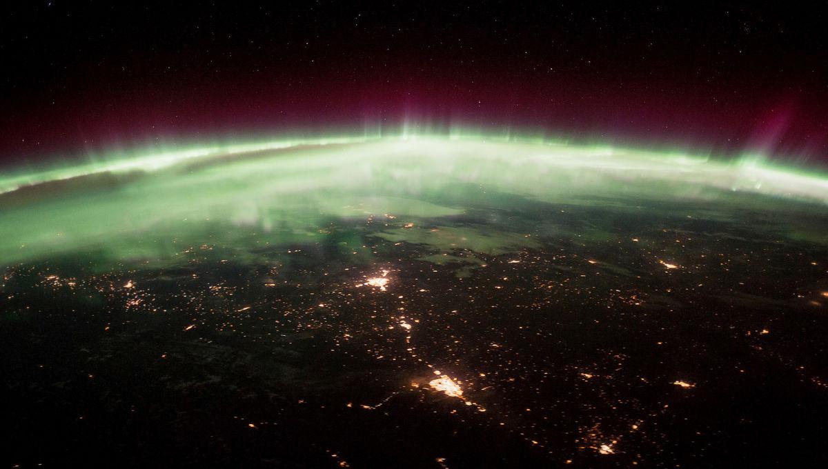 The Moon near Taurus setting into the aurora, as seen by the International Space Station. Credit: NASA/Seàn Doran