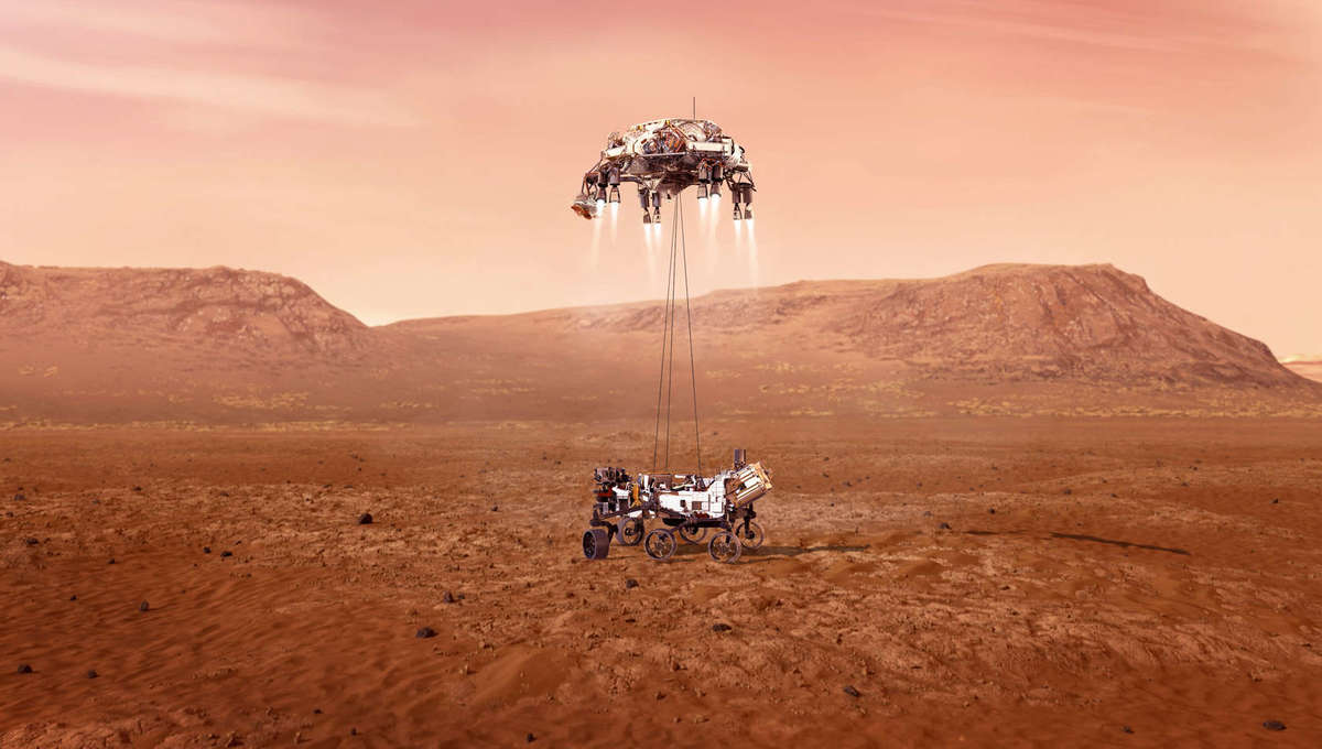 Artwork showing the Perseverance rover suspended by cables under the rocket-powered sky crane just as it lands on Mars. Credit: NASA/JPL-Caltech