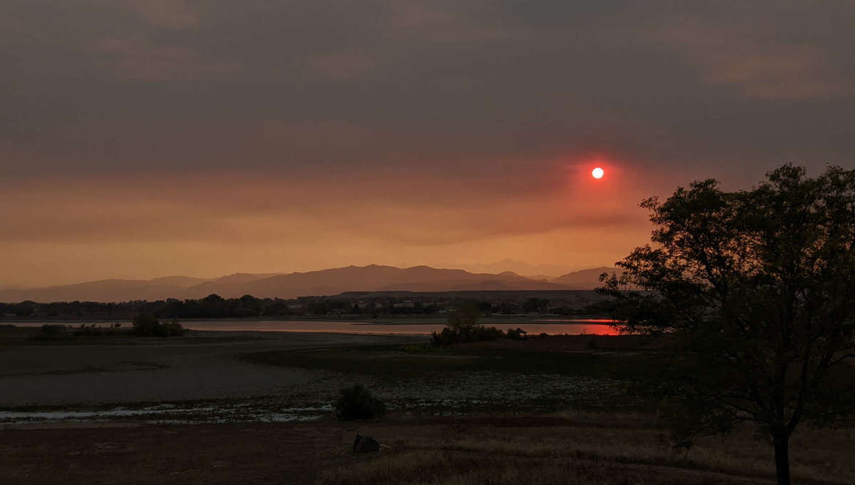 Sunset on a planet orbiting Betelgeuse? No, just our own Sun reddened in October 2020 by Colorado wildfires. Credit: Phil Plait