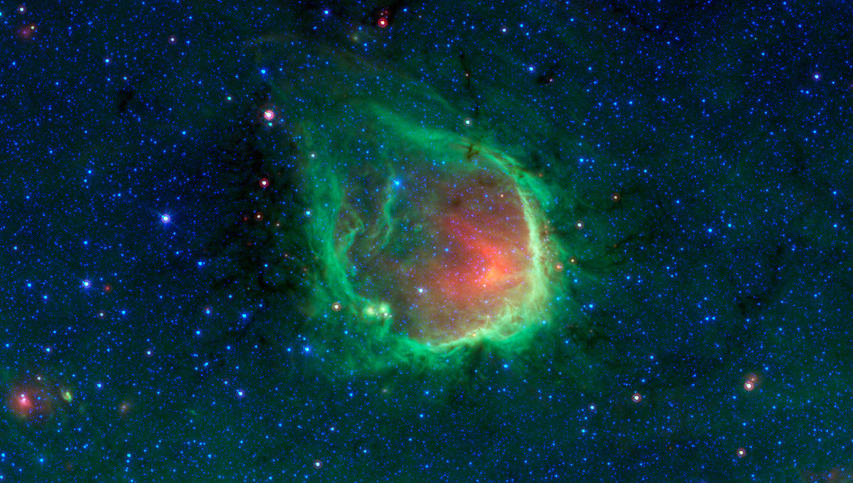 The huge shell of gas and dust that make up RCW 120, seen here in the far infrared by the Spitzer Space Telescope. Credit: NASA/JPL-Caltech/GLIMPSE-MIPSGAL Teams