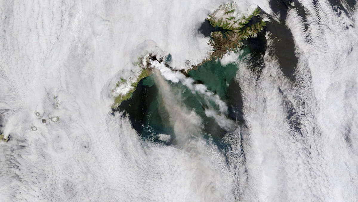 The 2008 eruption of Okmok seen from space by NASA's Terra satellite. The steam cloud (white) is well over 100 km long, and an ash/gas cloud can be seen below it. Credit: NASA image courtesy MODIS Rapid Response team