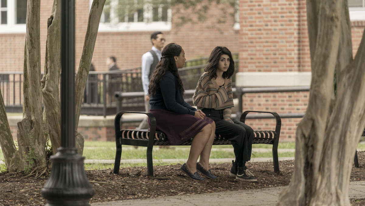 the walking dead world beyond episode 101 Hope and Iris sitting on a bench
