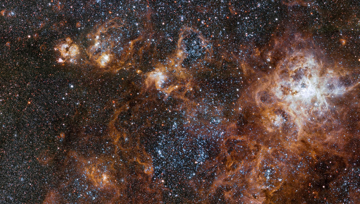 The hugely sprawling Tarantula Nebula, a vast star-forming complex in a nearby satellite galaxy of the Milky Way. It's currently making hundreds of thousands of stars. Credit: ESO